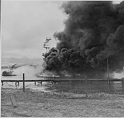 Battleship Arizona burning and settled on the bottom as seen from Ford Island, Pearl Harbor. Comp. Peter Chen. 1941. Photograph. World War II Database. Lava Development, LLC, n.d. Web. 16 July 2015.